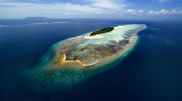 Aerial view of Mataking Island and the surrounding reef.
